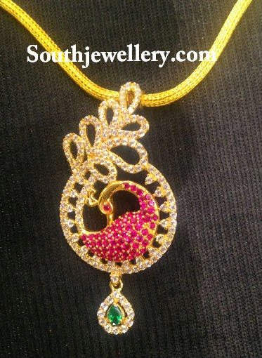 gold necklace with cz peacock pendant
