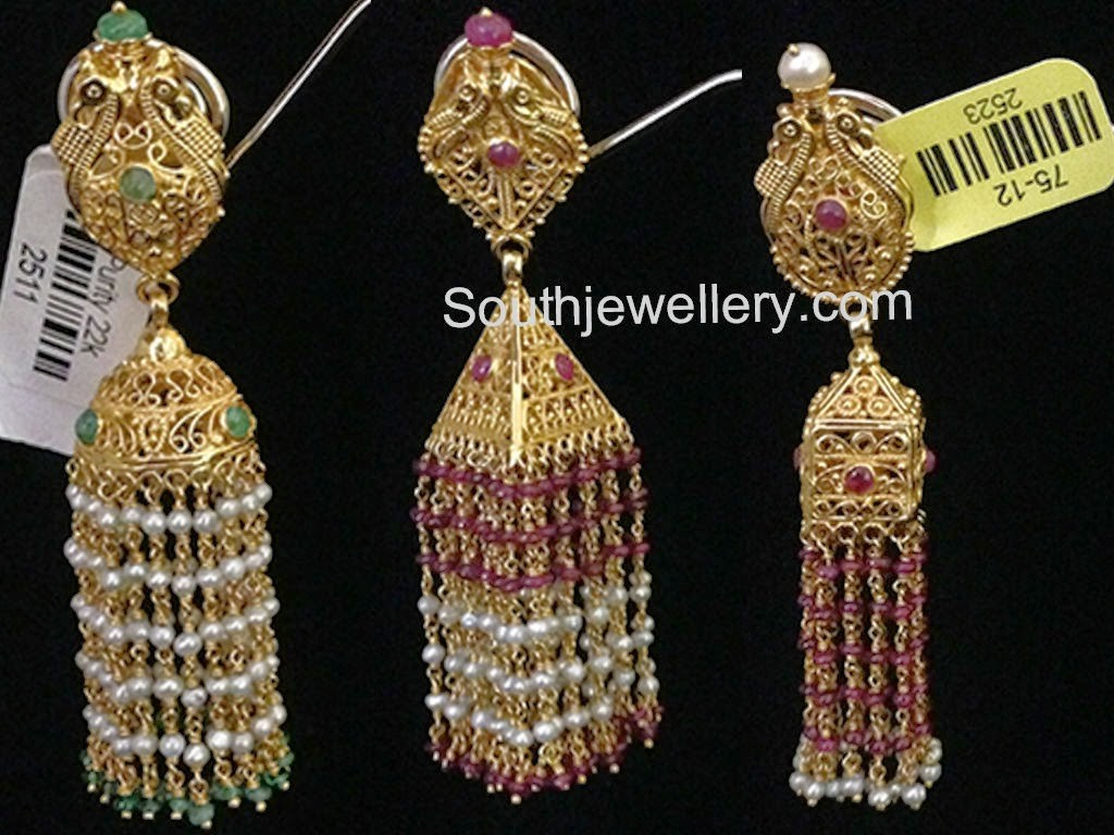 gold jhumkis with pearl and emerald beads