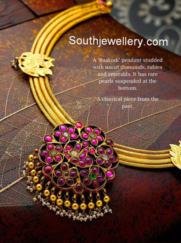 gold necklace with ruby pendant