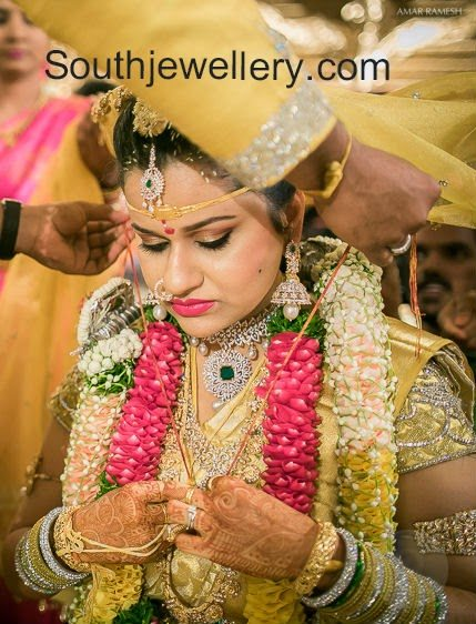 south indian brides in wedding jewelry