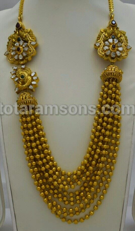 multi string gold balls necklace
