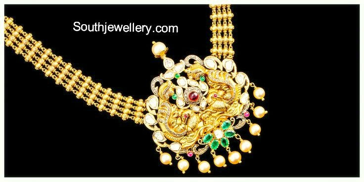 gold necklace with peacock pendant