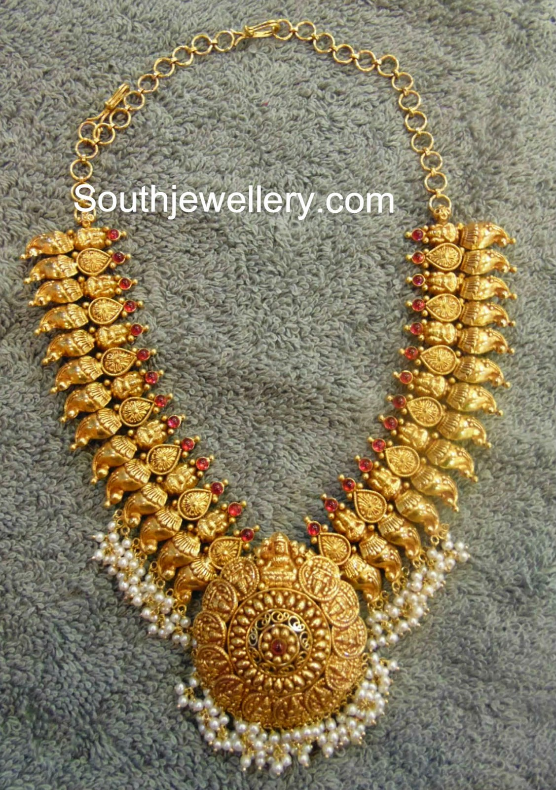 And contemporary gold jhumkas collection by khazana jewellery - Traditional Mango Necklace