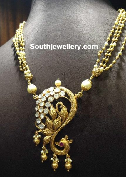 Antique Gold Necklace With Peacock Pendant Jewellery Designs