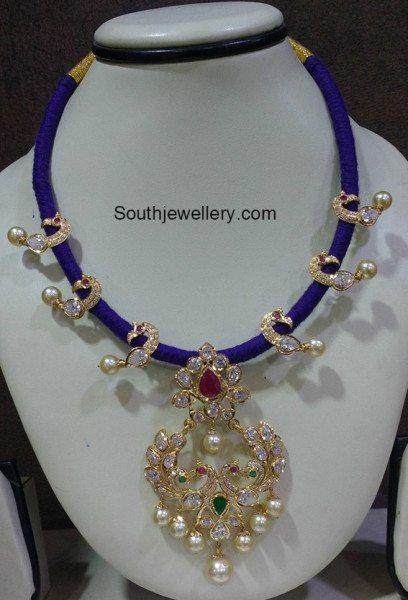 blue_dori_necklace_peacock_pendant