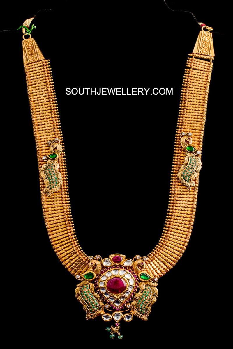 Suhasini in gundla haram jewellery designs - Antique Gold Peacock Haram