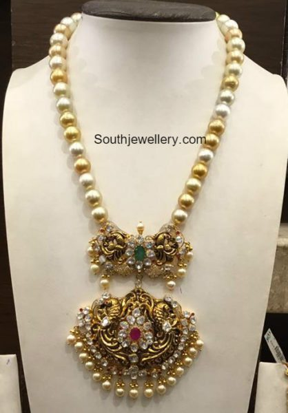 Multi string short pearl necklace with diamond ruby pendant by Tibarumal Ramnivas jewellers. Find this Pin and more on shopnow-jl6vb8f5.ga - Latest Indian Jewellery Designs by shopnow-jl6vb8f5.ga Jewellery Designs - Page 2 of - Latest Indian Jewellery Designs ~ 22 Carat Gold Jewelleryone gram gold.