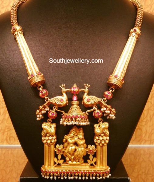 antique gold necklace with peacock krishna pendant