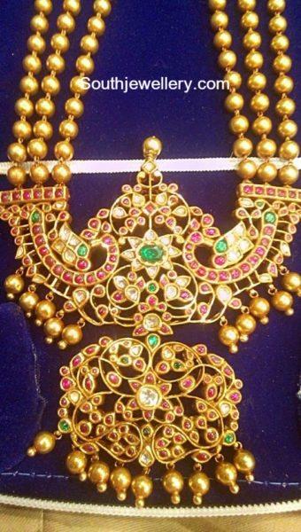 gold balls haram peacock padakkam