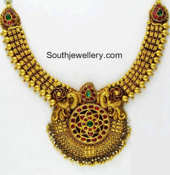 antique-gold-necklace-peacock-pendant
