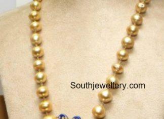 south sea pearls mala peacock pendant