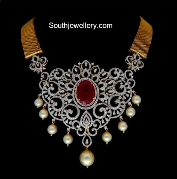 broad gold chain with diamond pendant