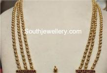 gold balls mala peacock pendant