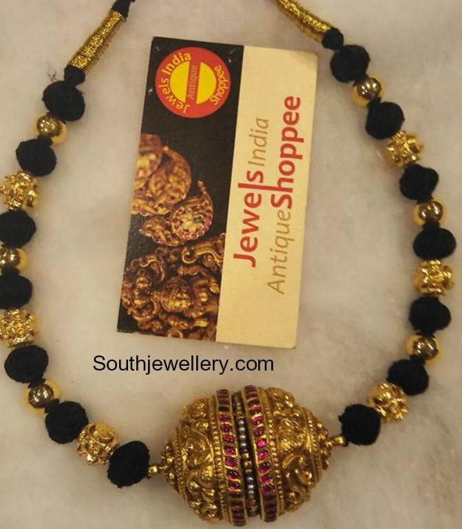 nakhsi balls and black thread necklace