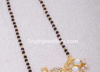 nallapusalu chain with peacock pendant