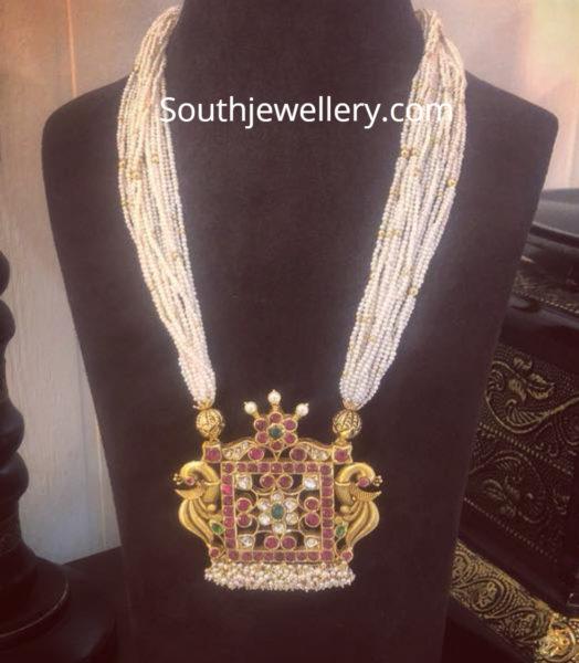 pearl mala with peacock pendant