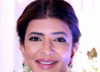 lakshmi manchu in emerald tassel earrings