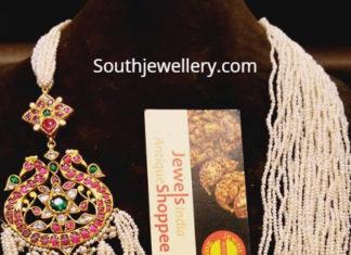 multi strand pearl necklace peacock pendant