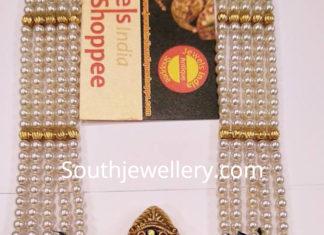 pearl mala with ram parivar nakshi pendant
