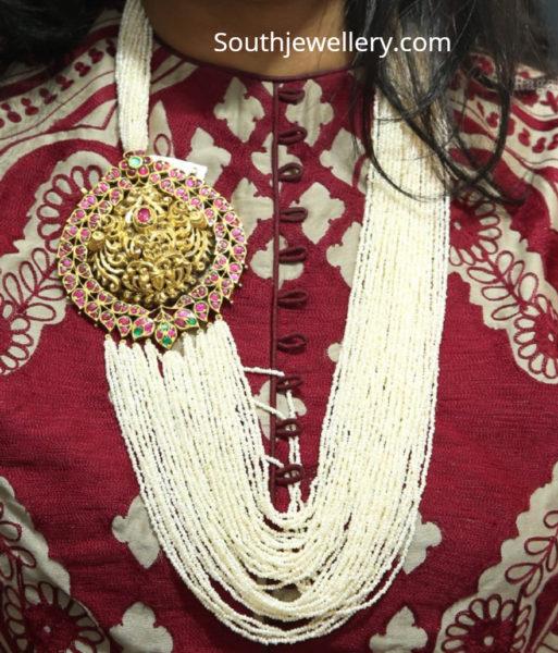 multi strand pearl mala with side pendant