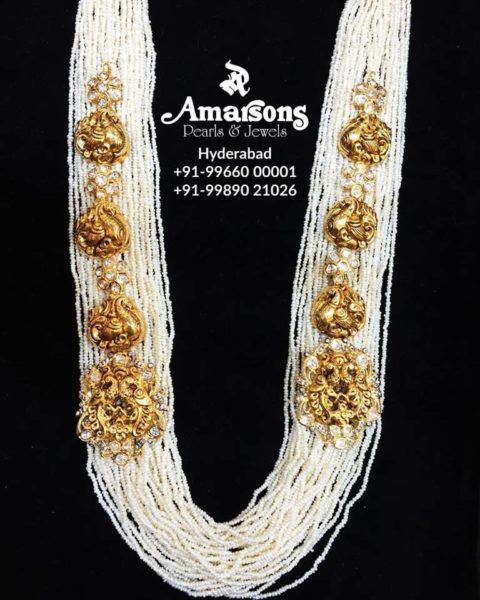 pearl necklace with gold brooches