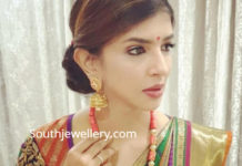 lakshmi manchu in a coral beads necklace