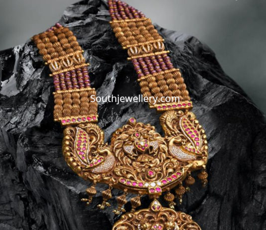 antique gold haram with peacock nakshi pendant
