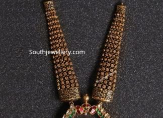 antique gold haram with peacock kundan pendant