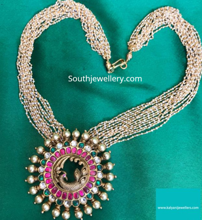 pearl necklace with peacock pendant
