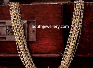 pearl necklace with antique gold pendant