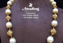 gold nakshi balls and pearl mala