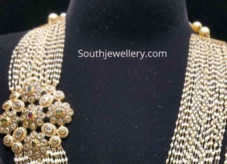multi strand pearl mala with sid ependant