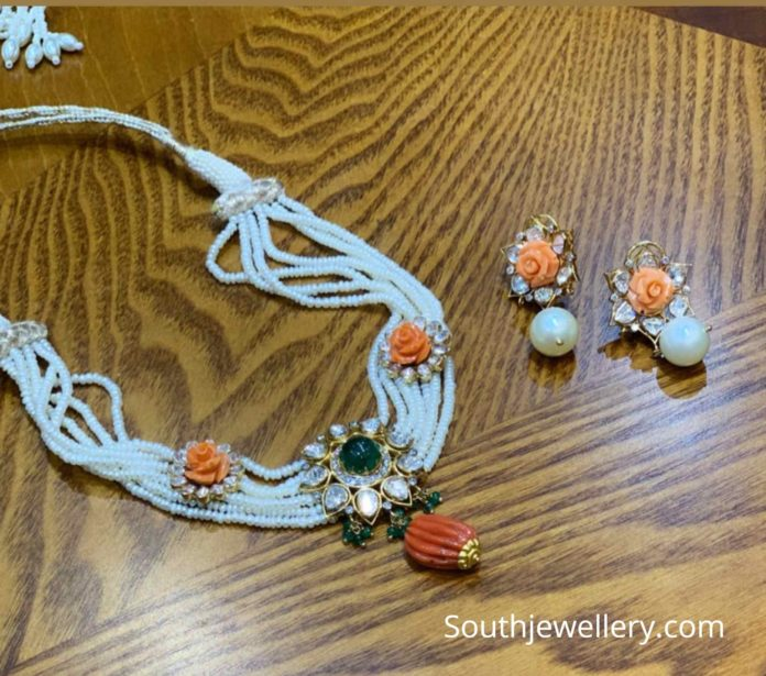 pearl necklace with coral roses