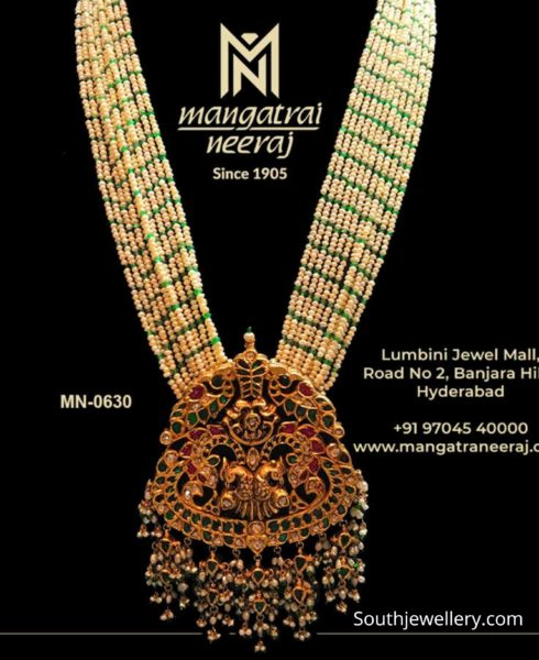 small pearl and emerald beads haram with lakshmi pendant