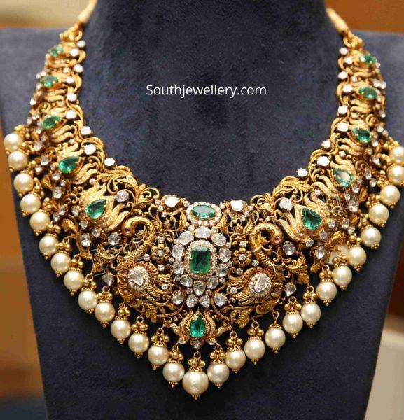 lotus design gold necklace