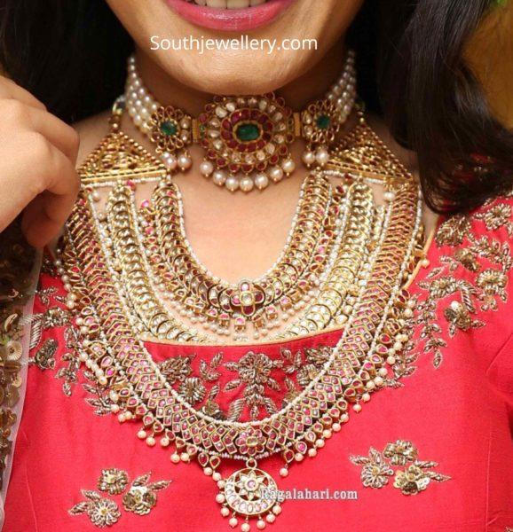 pearl choker and layered kundan necklace