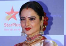 rekha in gold necklace and jhumkas