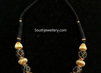 black thread nakshi balls necklace