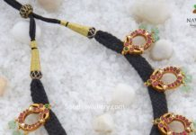 black thread necklace with kundan motifs