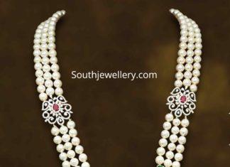 pearl haram with diamond pendant