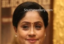 vijayashanti in black thread necklace with silver mango pendant