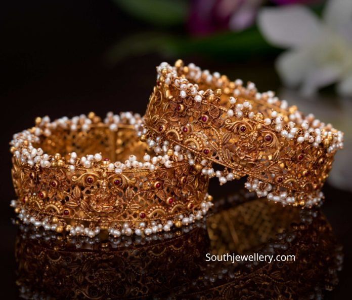 broad gold bangle designs by pmj jewels