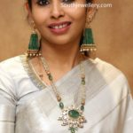 pearl long necklace and emerald earrings