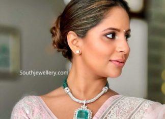 anushpala kamineni in diamond emerald necklace