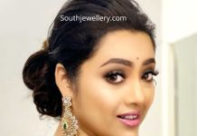 meena in diamond emerald earrings