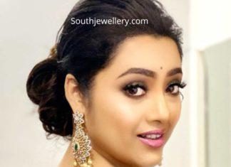 meena in diamond emerald earrings