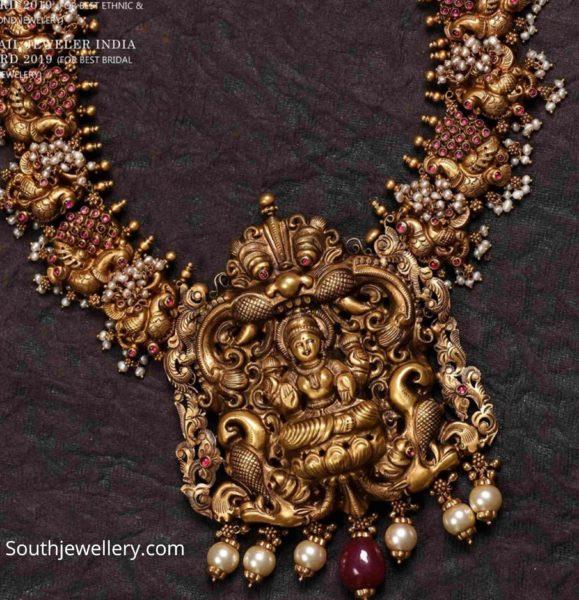 peacock gold necklace with lakshmi pendant