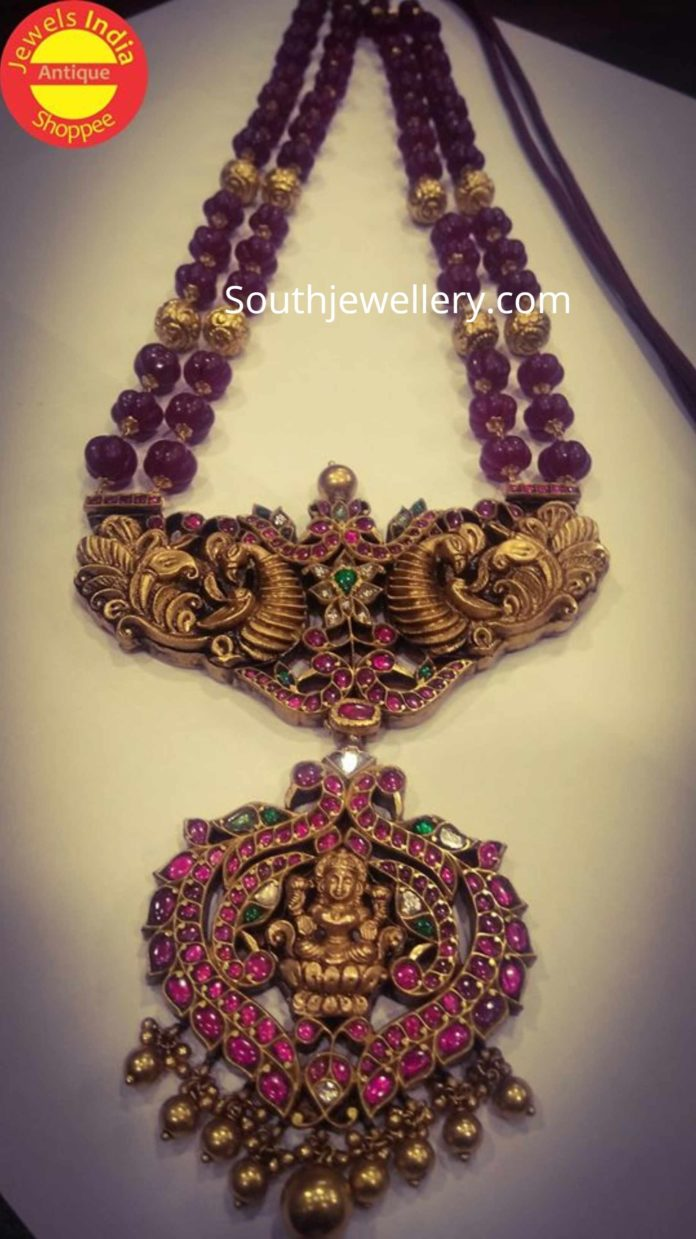ruby beads necklace with peacock lakshmi pendant