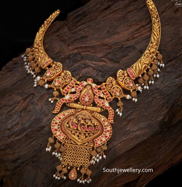 antique nakshi necklace with peacock pendant
