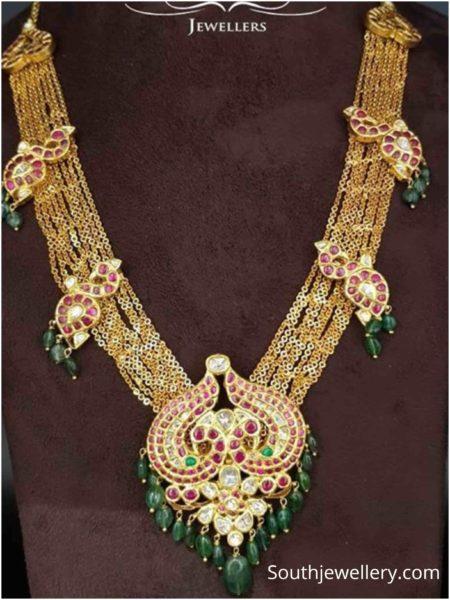 gold chandra haram with peavcock motifs
